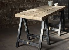 LOMWE TRESTLE TABLE BLACK Furinsh your home office, kitchen or dining room with this elegant trestle table. Made to order as part of our bespoke wooden furniture collection the black legs create a beautiful contrast to the gorgeous natural wood table top.