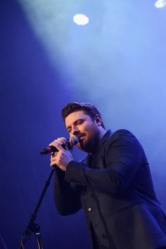 Chris Young Photos Photos - Chris Young performs  during 1 Night. 1 Chris Young performs during 1 Night. 1 Place. 1 Time: A Heroes & Friends Tribute to Randy Travis at Bridgestone Arena on February 8, 2017 in Nashville, Tennessee. (Feb. 7, 2017 - Source: Rick Diamond/Getty Images North America) Place. 1 Time: A Heroes & Friends Tribute to Randy Travis at Bridgestone Arena on February 8, 2017 in Nashville, Tennessee. - 1 Night. 1 Place. 1 Time: A Heroes & Friends Tribute to Randy Travis