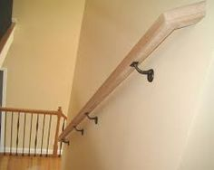 Image result for modern wood wall mounted handrails.  I like how the ends turn into wall, brackets are a bit ugly...