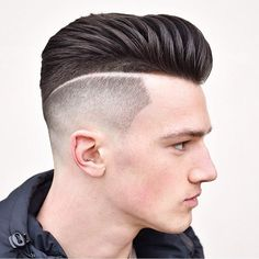 This modern pomp features a high fade, shaved line and textured styling. #menshair #menshaircuts #menshairstyles #pompadour #pompadourhaircut #pompadourhairstyle #pomp #pompfade #menshairtrends #menshair2018