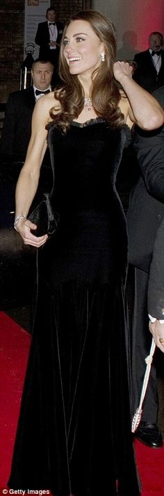 Kate Middleton in a black velvet gown by Alexander McQueen, Pretty Ballerinas velvet clutch bag - Military awards evening, December 2011.