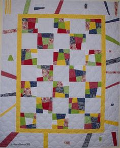 Crazy nines - I intuitively pieced the border with left over fabric - it was professionally quilted.