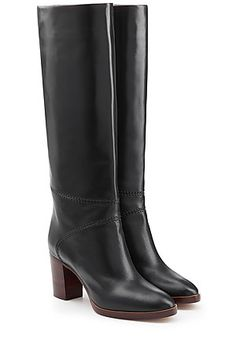 Chloé's black leather knee boots are finished with a retro wooden heel and a wider shaft - making them super comfortable and easy to style. Tap into the sleek but bohemian aesthetic by pairing with a denim skirt or crochet dress #Stylebop