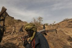 The Sudan Liberation Army led by Abdul Wahid (SLA-AW) climb towards the front lines in the last rebel-held territory in Central Darfur, Sudan, March © Adriane Ohanesian Haunting Photos, Contemporary Photography, Award Winner, Top Photo, Photojournalism, Awards, March 4, Image, Army