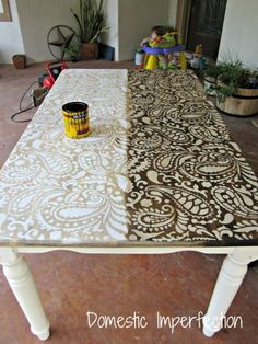 Paint over stencil then stain. Tabletop