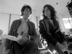 John Densmore mugging for the camera while waiting beside Jim Morrison for their flight out of LAX on April 18, 1968