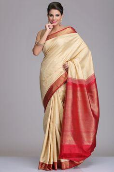 Self-Patterned Cream Kanjivaram Pure Silk Saree With Real Zari And Maroon & Gold Border And Pallu