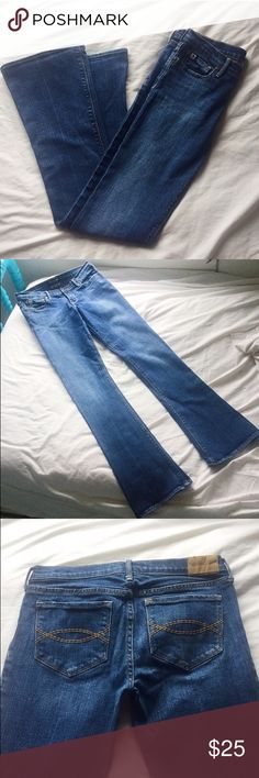 Abercrombie Women's Low Rise Bootcut Jeans Beautiful Makenzie style jeans by Abercrombie! Perfect condition; no flaws!!! Still extremely blue with no wear whatsoever. Features a bootcut flair leg, neat hem, 2 functioning buttons in the front and back, zipper and button closure, and a lowrise style. They are size 16 Slim in Makenzie style. Again, perfect condition! Feel free to make me an offer! Abercrombie & Fitch Jeans Boyfriend