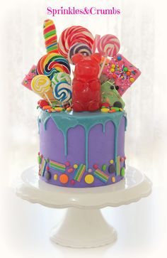 wonka drip cake featuring a giant gummy bear.