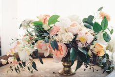 ranunculus and camellia centerpiece by Finch + Thistle Event Design, Seattle | O'Malley Photographers