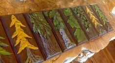"""These are plinth.  I wanted a unique window trim for the gable windows in our log home.  I sculpted these with a vinyl putty using """"real leaf fossils"""" as embellishments. These depict 5 species of plants that are prevalent on our property:  Tamarack (summer & fall), huckleberry, thimble berry, cedar, & birch."""