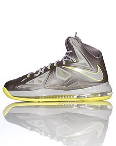 NIKE High top men's sneaker Lace up closure Padded tongue with LEBRON logo Signature NIKE swoosh on sides of shoe Cushioned sole for ultimate comfort