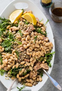 From our blog: Tuna, White Bean, and Arugula Salad -- If you've got leftover quinoa in the fridge, there's noooo cooking here. Nice!