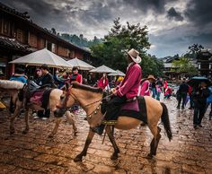 Man on Horse in Lijiang Square photo from #treyratcliff Trey Ratcliff at www.StuckInCustom... - all images Creative Commons Noncommercial