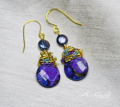 Two lovely natural purple Turquoise stones are wire wrapped with gold and aqua seed beads while dangling from freshwater pearls and 18kt gold vermeil ear wires, on ETSY.