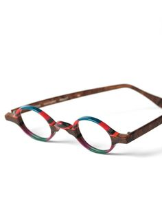 Our multi-colored frames are works of art, struck in the appealing patterns shown, each with complementary colorful temples. Funky Glasses, New Glasses, Prada Eyeglasses, Eye Frames, Shades Of Teal, Handmade Frames, Oval Frame, Reading Glasses, Eyewear