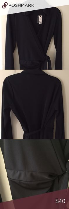 NWT Limited Black Wrap Dress • Sz M NWT super cute and comfy black wrap dress from The Limited. Long sleeved with button cuffs. Only selling because it's no longer my size. Size M. The Limited Dresses