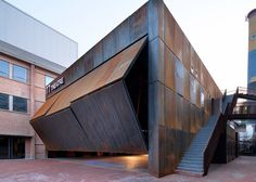 A huge folding wall lifts up to reveal the contents of this theatre complex.