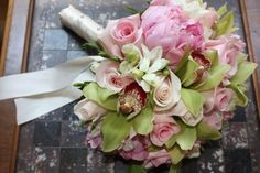 Green Cymbidium Orchids, Sophie Roses, white Freesia, pink Peonies and Candy Bianca pale pink Roses.