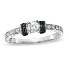 I've tagged a product on Zales: 1/4 CT. T.W. Enhanced Black and White Diamond Station Engagement Ring in 10K White Gold