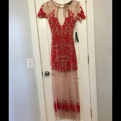 "🎊HPx2🎊For Love & Lemons Luau Maxi Dress This dress is NWT! The dress is sheer, nude mesh with red floral embroidery. It is partially lined with nude lining. It has a tie back with a side zipper. Short sleeved. It is approximately 14"" across the bust when laid flat. It is approximately 61 1/2"" long. The shoulder to end of lining measurement in the skirt is approximately 34"".  Self:  100% polyester   Lining:  90% polyester, 10% spandex For Love and Lemons Dresses Maxi"