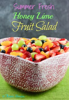 Summer Fresh Honey Lime Fruit Salad with strawberries, blueberries, green grapes, pineapple with a honey lime dressing.