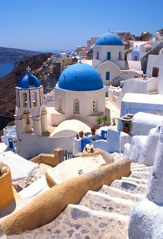 The iconic blue-domed churches of Oia village on the Greek island of Santorini