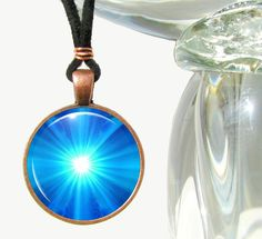 This is a bright blue chakra necklace in my energy art line of reiki jewelry. Bright, flashy, and eye catching, this energy pendant necklace can be used for its healing energy or as a bold fashion sta