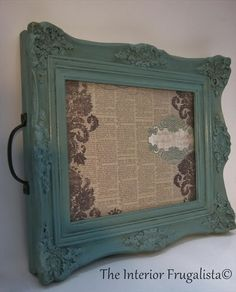 Thrift store picture frame painted with Provençe chalk paint and scrapbook paper under the glass