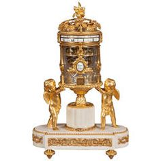 Antique Marble, Ormolu, and Glass French Mantle Clock