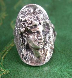 Art Nouveau Antique Ring Women's Figural Head 3D Sculpture Size 7 Ladies Fashion Jewelry. A perfect addition to a collection or a gift to that special someone. Maker: unknown Material: sterling silver, 9.9 grams Size: see photo Weight: light/medium Condition: In good vintage pre-owned condition. Lovely patina! Boxed for gift giving; gift wrapped on request. These are part of a MASSIVE estate collection of cufflinks and jewelry so be sure to check out our other items here: ...