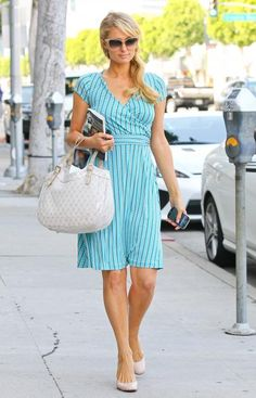 Paris Hilton's Down-to-Business Style. Paris has her pick of the latest styles straight off the runway, but she also knows the importance of acquiring a few wardrobe staples. A structured handbag and nude pumps complement a bright wrap dress, but also can go with any number of items in your closet.