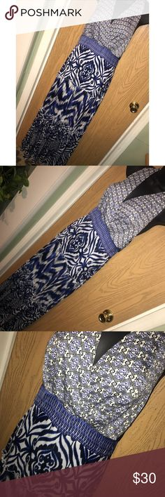 """Blue printed Eva Mendes halter maxi dress Gorgeous blue printed halter maxi dress. Zipper on the back.  ❗️Please no low ball offers.❗️ ❗️Bundles always get a discount.❗️ Condition: Great, used  Measurements- Armpit to armpit: 19"""" stretched across the back Armpit to hem: 51"""" Flat across the waist: 15"""" Smoke free home but I have a small dog.  Thanks for checking out my closet! ❤️ New York & Company Dresses Maxi"""