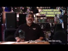 George Villavicencio, owner of DJ BAND SUPPLY, Shows appreciation for being awarded WEST RISING STAR 2013 by CHAUVET DJ.