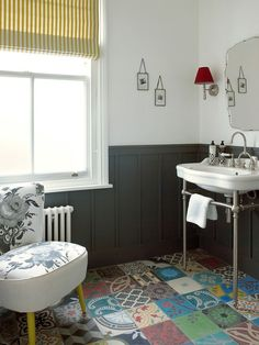 Vivacious patchwork tiled flooring adds color to this classy powder room in London home A Timeless Affair: 15 Exquisite Victorian Style Powder Rooms