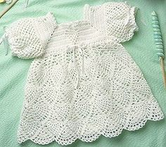 Whipped Cream Baby Dress Free Crochet Pattern. An allover pattern of shells and cluster stitches creates the look of tiny pineapples on the skirt of this sweet dress. The yoke and shoulders also have lacy highlights. The outfit is crocheted using baby fingering weight yarn and size D and E hooks. Children's Size: 12 to 18 months Free Pattern More Patterns Like This!