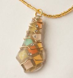 wire wrapped recycled glass pendant. Autumn Gold Plaid Wire Wrapped Seaglass Necklace, Swarovski Crystal, Gifts Under 20. Recycled GlassGlass PendantsBlack Glass Pendant
