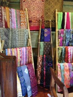 Local textiles displayed on bamboo ladders Ubud, Bali