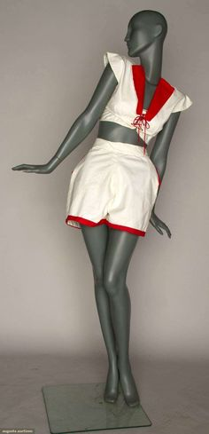 early 1940s white cotton twill, red cotton trim shorts and 2 tops: 1 bikini, strapless w/tie front and 1 midi-length top, cap sleeves, and cut out back and front lacing.