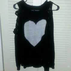 Black sweater with heart Black cut out sleaves with white heart in thr middle. Excellent condition.  Never worn. Forever 21 Tops