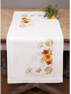 Vervaco Sunflowers and Poppies Table Runner - Cross Stitch Kit. This complete cross stitch kit includes 14 count Aida fabric, 100% cotton DMC embroidery floss,