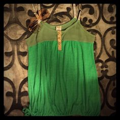Free people tank Super cute green Free People tank in large. Floral adjustable straps and a drawstring tie bottom! Full of color lots of life left in this one!!! NO PILING NO STAINS NO RIPS NO HOLES!!! Free People Tops Tank Tops