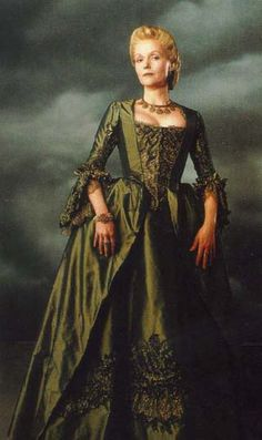 """Actress Miranda Richardson plays the restrained Lady Mary van Tassel in """"Sleepy Hollow"""" (1999). While set in 1799, the costumes from the film are more reminiscent of the 1730s to the 1780s. Lady van Tassel's forest green gown was no exception- loosely inspired by Rococo fashions, it included a heavily embroidered stomacher and pocket hoops to create the full shape of the skirt."""
