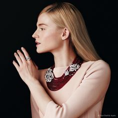 "Van Cleef & Arpels new ""Jewelry and Watches"" catalog. Mehndi necklace, Palais de la chance collection, white gold, diamonds, 3050 ruby beads for 1043.92 cts (origin: Madagascar). Deva ring, Pierres de Caractère collection, platinum with round and taper diamonds and one pear-shaped DFL diamond of 12.54 carats."