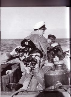 German U-96 just out of base, Captain making sure lookouts are up to standards; note it's a new patrol no beards.