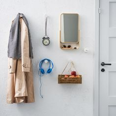 An organised wall with knobs by the door