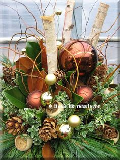 Heidi Horticulture: Outdoor Winter Container Designs. Really like the bronze and cream/gold theme