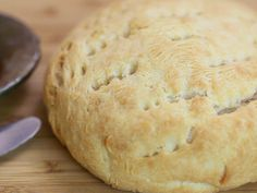 Bannock is a very simple bread that can be baked, fried, or cooked over an open fire. Mix some all-purpose white flour in a bowl; you can add in a handful of cornmeal or whole other grain (wheat, multi-grain, oat, corn).