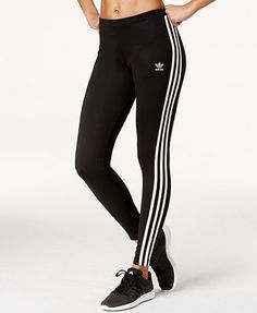 With the traditional three-stripe insignia and a sleek stretch fit, these adidas Originals leggings combine the best of classic and contemporary. | Cotton/spandex/elastane | Machine washable | Importe