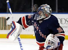 New York Rangers goalie Henrik Lundqvist, of Sweden, makes a save against the New Jersey Devils during the first period of a NHL hockey game at Madison Square Garden on Sunday, Oct. 18, 2015, in New York. (AP Photo/Adam Hunger)